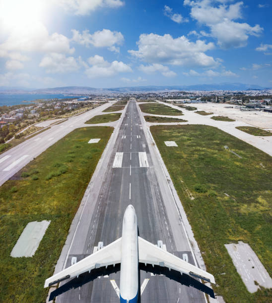 Aerial view of an airplane standing on a airport runway stock photo