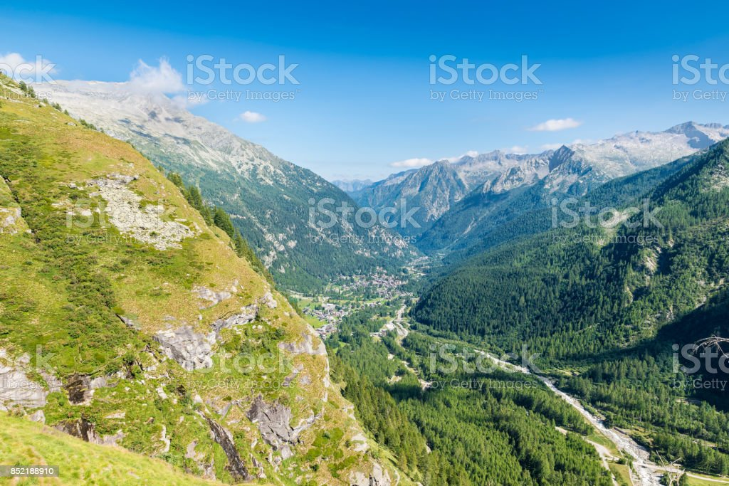Aerial view of an alpine valley, example of glacial valley. Anzasca Valley,at the foot of Mount Rosa, with the characteristic villages of Macugnaga (Staffa - Pecetto) and Borca, Piedmont, Italy stock photo