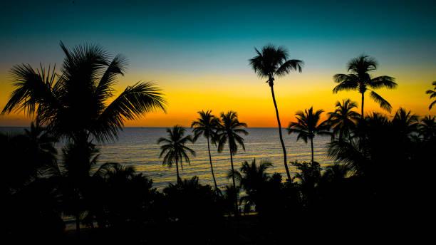 aerial view of an amazing silhouette sunset in La Romana, Dominican Republic, Caribbean Sea stock photo