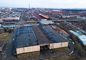 istock Aerial view of an industrial area and a factory. Heavy industry plant and roof of the warehouse. 1316825244