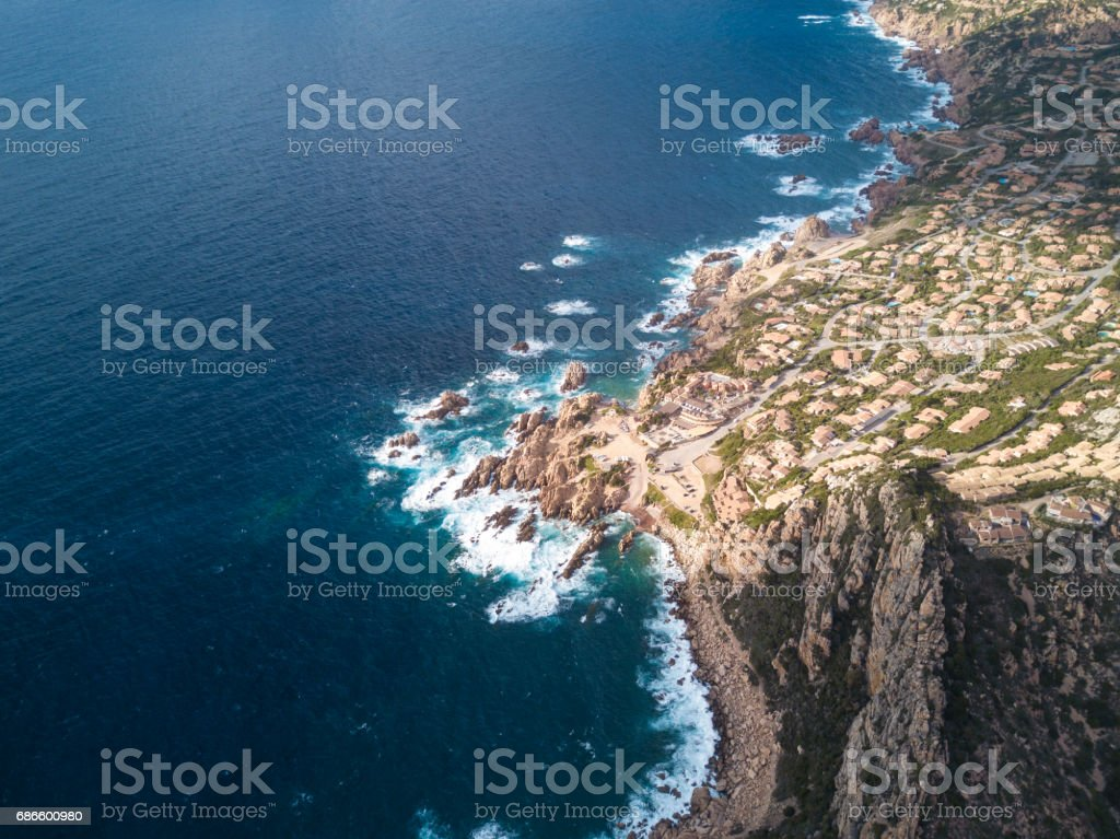 Aerial view of an Italian city on the coast of Sardinia at sunset. Castelsardo, Sardinia, Italy. royalty-free stock photo