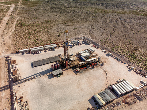 Drone view of an oil and gas drill rig, fracking in West Texas, near Pecos