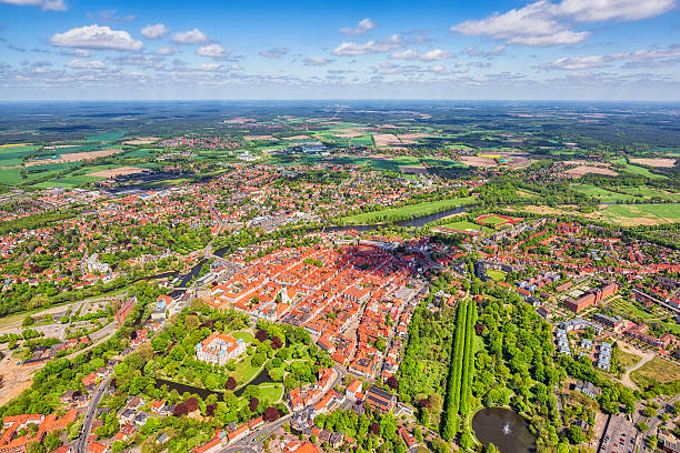 Aerial View of ancient downtown district Celle , Lower Saxony Aerial View of ancient town center Celle with Celle Castle and Castle Park , Lower Saxony , Germany. Celle is a town and capital of the district of Celle, in Lower Saxony, Germany. The town is situated on the banks of the River Aller, a tributary of the Weser and has a population of about 71,000. Celle is the southern gateway to the Lüneburg Heath, has a castle (Schloss Celle) built in the renaissance and baroque style and a picturesque old town centre (the Altstadt) with over 400 timber-framed houses, making Celle one of the most remarkable members of the German Timber-Frame Road. lower saxony stock pictures, royalty-free photos & images