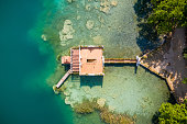 aerial view of ancient fishing house in Estany de banyoles lake