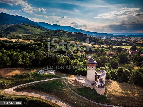 Malaiesti, Romania - 15 July, 2020: Drone shot depicting an aerial perspective of an ancient ruined and abandoned fortress in the heart of the Transylvania region of Romania.
