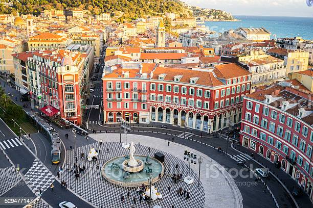 An aerial view of the Fontaine du Soleil in Place Messena, Nice. With  the new tram track and buildings of Nice and the sea in the background.
