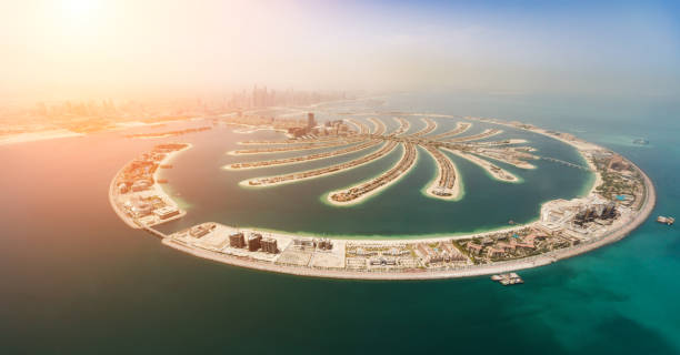 Aerial view of artificial palm island in Dubai. Aerial view of artificial palm island in Dubai. Panoramic view. dubai stock pictures, royalty-free photos & images