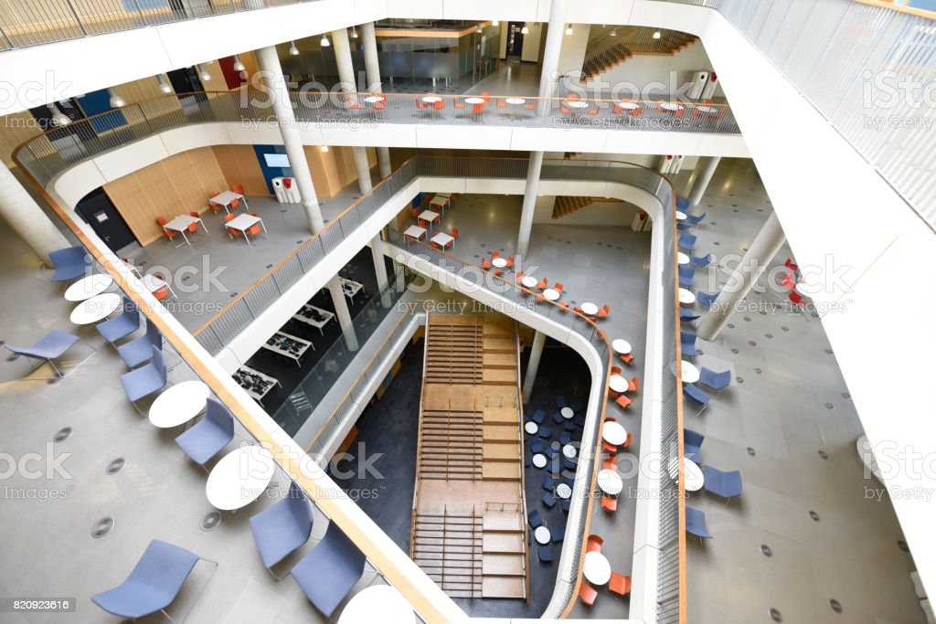 Aerial view of atrium and staircase in modern university building stock photo