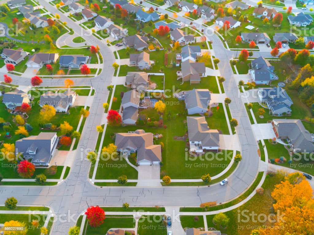 Aerial view of Autumn Neighborhood with scenic curvy roads. stock photo