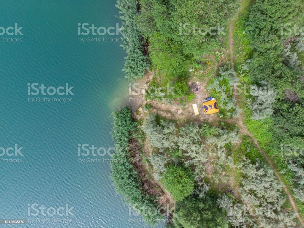 aerial view of azure water with green beach. tent on beach. stock photo