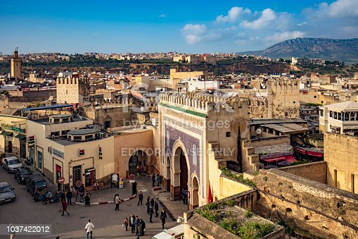 Fez, Morocco - February 25, 2017: Aerial view of people around Bab Bou Jeloud gate, Blue Gate in Fez, Morocco.