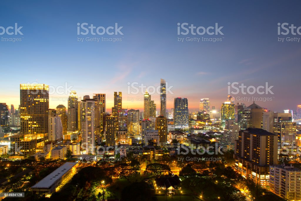 Aerial view of Bangkok modern office buildings, condominium in Bangkok city downtown with sunset sky ,Bangkok is the most populated city in Southeast Asia. Bangkok , Thailand stock photo