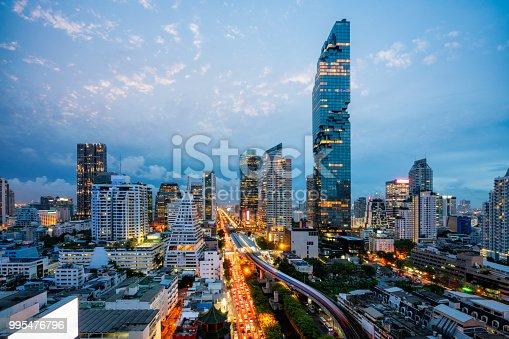 Aerial view of Bangkok skyline and skyscraper with BTS skytrain Bangkok downtown. Panorama of Sathorn and Silom business district Bangkok Thailand at night.