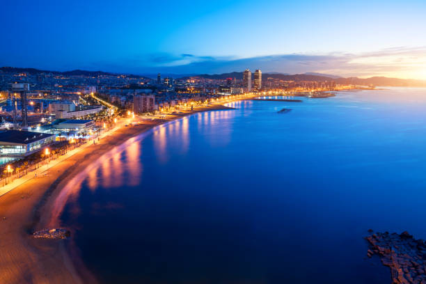 Aerial view of Barcelona Beach in summer night along seaside in Barcelona, Spain. Mediterranean Sea in Spain. Aerial view of Barcelona Beach in summer night along seaside in Barcelona, Spain. Mediterranean Sea in Spain. barcelona spain stock pictures, royalty-free photos & images