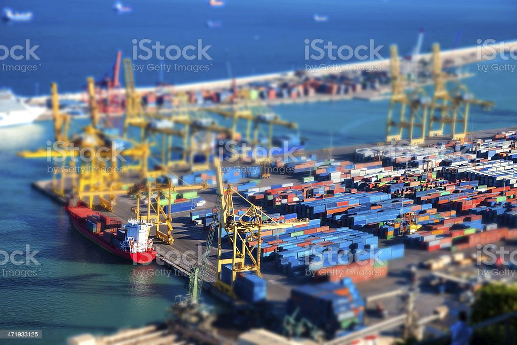 Aerial view of Barcelona harbor Aerial view of Barcelona harbor with containers, cranes and cargo ship. Aerial View Stock Photo