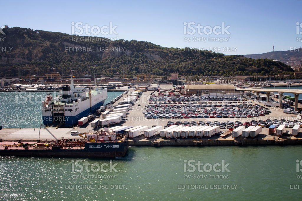 Aerial view of Barcelona port. Big transportation ships are waiting to depart. Many cars and containers to be shipped. It's as one of Europe's important harbors in the Mediterranean. stock photo