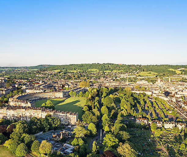 Aerial View of Bath, England Evening view from a hot air balloon of the historic English city of Bath, with Royal Crescent visible to the left. somerset england stock pictures, royalty-free photos & images