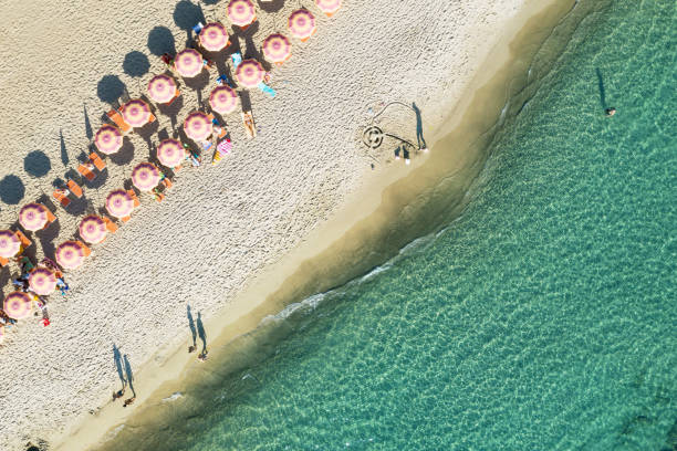 Aerial view of beach in Italy with parasols stock photo