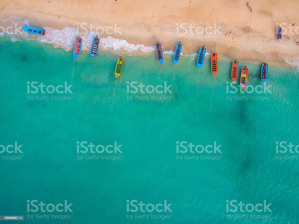 Aerial view of beach with boats stock photo