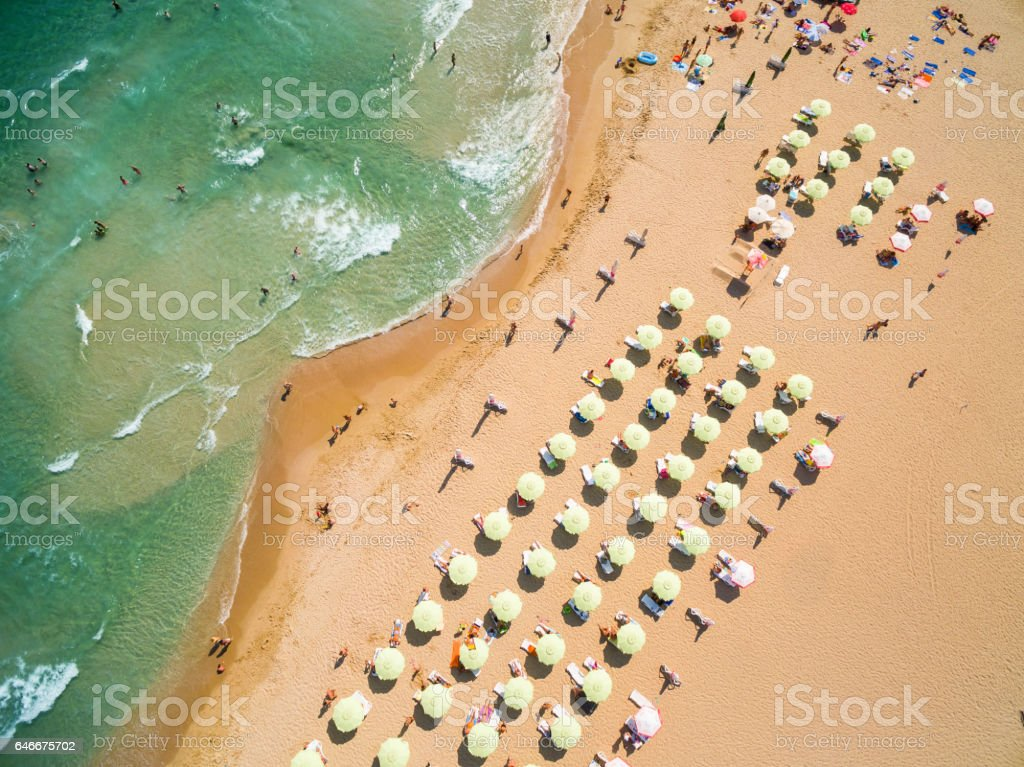 Aerial view of beach with tourists on vacations stock photo