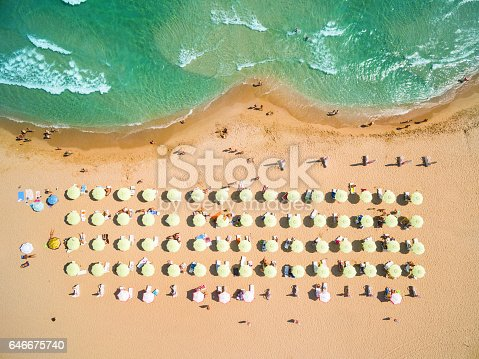 istock Aerial view of beach with umbrellas 646675740