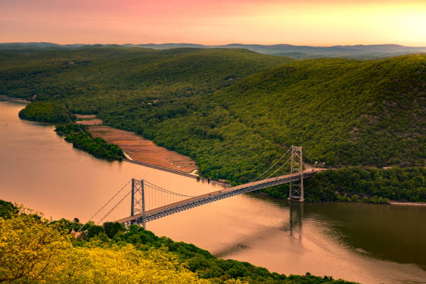 Aerial view of Bear Mountain Bridge at sunrise. Aerial view of Bear Mountain Bridge at sunrise. Bear Mountain Bridge is a toll suspension bridge in New York State, carrying U.S. Highways 202 and 6 across the Hudson River hudson river stock pictures, royalty-free photos & images