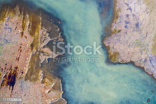Aerial view of beautiful natural shapes and textures in lake. Taken via drone.