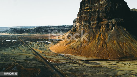 Drone photo of sunset above Lomagnupur mountain and volcanic landscape in Iceland