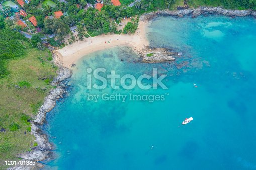 Aerial view of beautiful tropical beach and sea with palm and other tree in Phuket island for travel and vacation. Yanui Beach