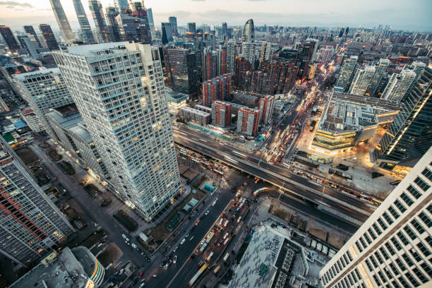 aerial view of beijing skyline at dusk - urban sprawl stock photos and pictures