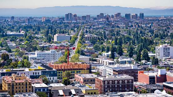 istock Aerial view of Berkeley and north Oakland on a sunny day; downtown Oakland in the background; buildings in UC Berkeley in the foreground; San Francisco bay, California 1163788841