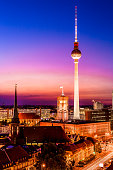 Panoromic aerial view of Berlin skyline with famous TV tower and Spree river in beautiful post sunset twilight during blue hour at dusk with dramatic colorful clouds , central Berlin Mitte, Germany