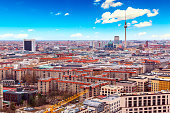 istock Aerial view of Berlin skyline with famous TV tower at Alexanderplatz and blue sky in Germany. 1226441720