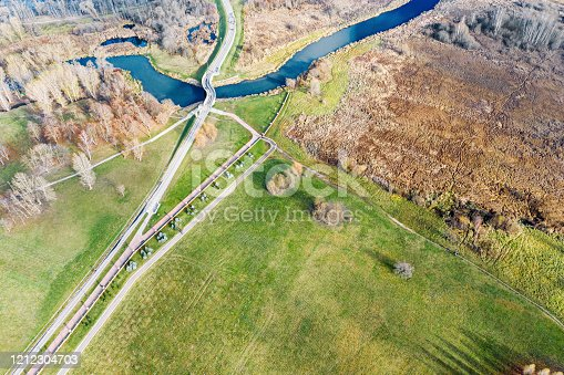 969439086 istock photo aerial view of bicycle lane going through suburb area 1212304703