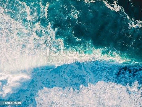 843079528istockphoto Aerial view of big wave with foam. Blue ocean waves 1138967948