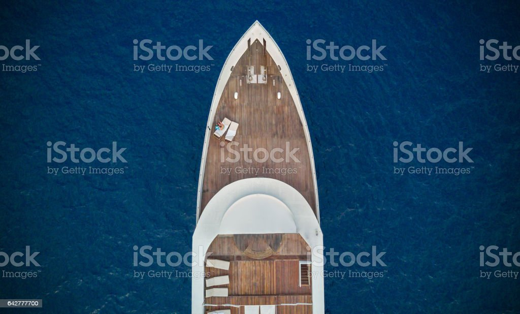 Aerial view of big yacht in sea stock photo