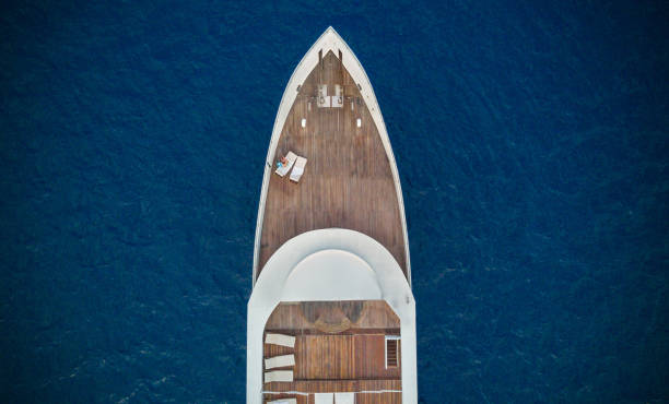 aerial view of big yacht in sea - yacht front view stock photos and pictures