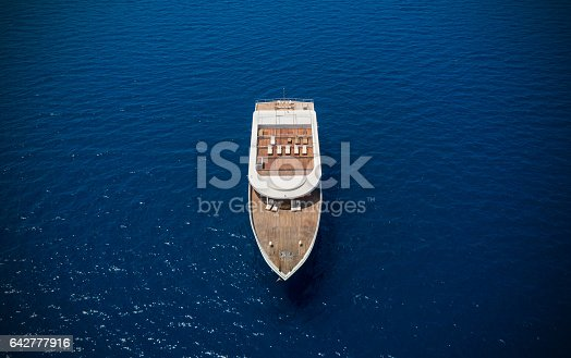 istock Aerial view of big yacht in sea 642777916