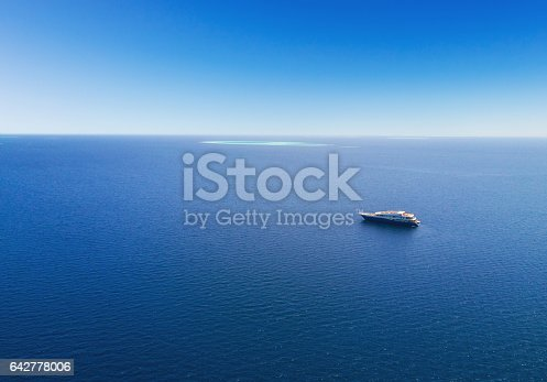 istock Aerial view of big yacht in sea 642778006