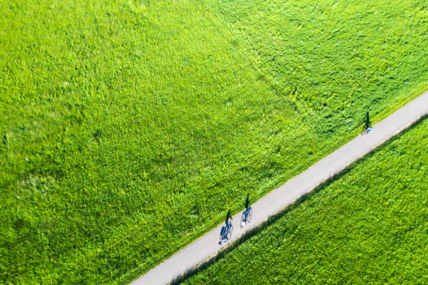 Aerial view of bikers in grassland stock photo