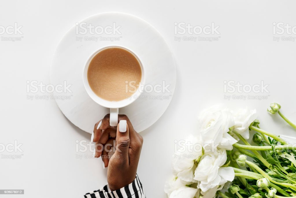 Aerial view of black woman drinks coffee stock photo