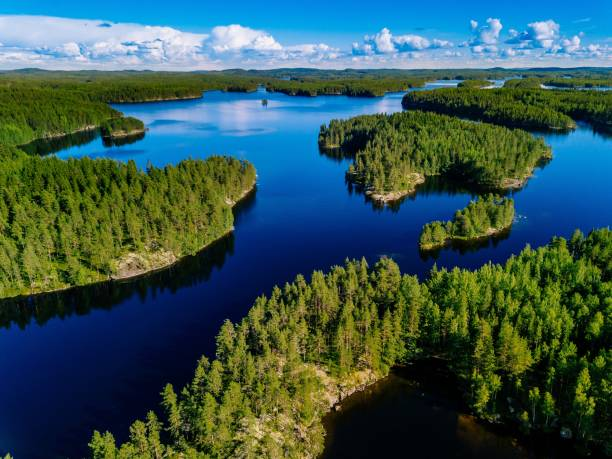 aerial view of blue lakes and green forests on a sunny summer day in finland. - finland stock pictures, royalty-free photos & images