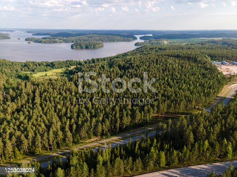 istock Aerial view of  blue lakes with sun light forest in Finland Lapland. 1253038024