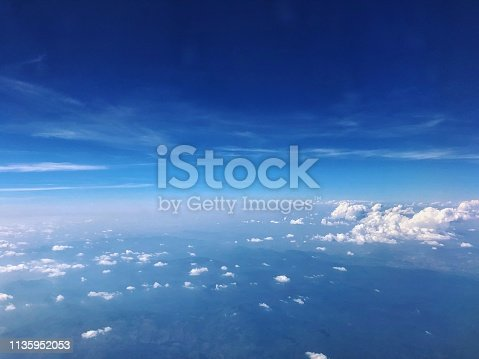 Aerial view of blue sky and cloud top view from airplane window.