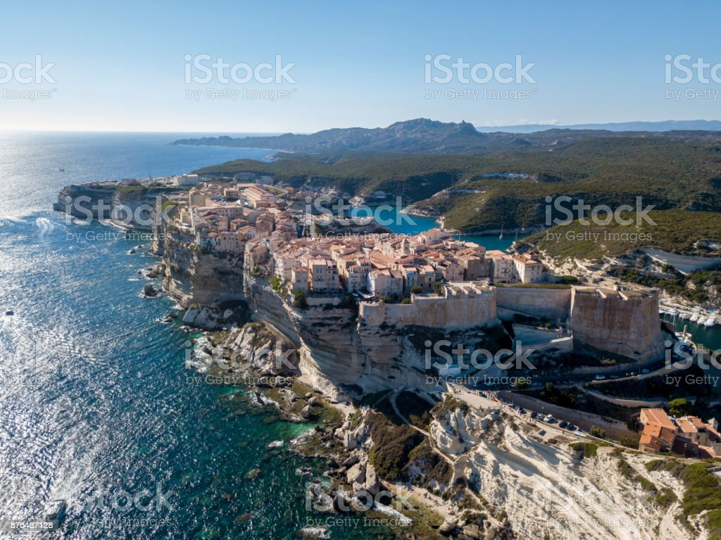 Aerial view of Bonifacio old town built on cliffs of white limestone, cliffs. Harbor. Corsica, France. stock photo