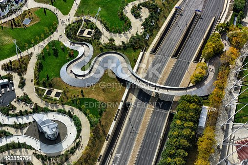Chicago, USA - October 17, 2015: Aerial view of the BP Pedestrian Bridge connecting Millennium Park with Maggie Daley Park in The Loop, downtown Chicago. Autumn view with distant pedestrians.