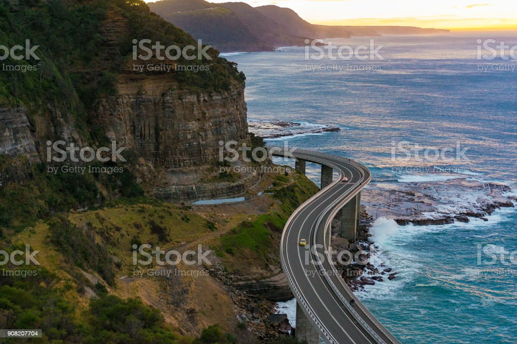 Aerial view of bridge along cliff edge and ocean stock photo