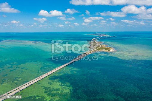 Drone point of view shot of a bridge and islands in the sea under a blue sunny sky, Key West, Florida, USA