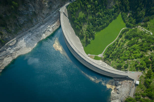 Aerial view of bridge on large dam in Swiss Alps stock photo