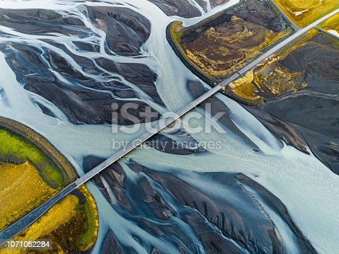 istock Aerial view of bridge over braided river. 1071052284